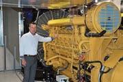 Nicht zuletzt dank zwei leistungsstarken Dieselmotoren könne das Rechenzentrum Ostschweiz eine Verfügbarkeit von 99,998 Prozent vorweisen, erklärt CEO Christoph Baumgärtner. Das Datenzentrum erreicht dadurch das höchste Branchen-Qualitätslabel «Tier 4». (Bild: Bruno Eisenhut)