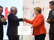 Der portugiesische Ministerpräsident Costa und die deutsche Kanzlerin Merkel bei der Einweihung eines Entwicklungs- und Technologiezentrums des Konzerns Bosch. (Bild: KEYSTONE/EPA LUSA/HUGO DELGADO)