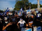 Demonstrierende in Managua mit Fotos von Personen, die bei früheren Kundgebungen in Zusammenstössen mit der Polizei getötet wurden. (Bild: KEYSTONE/AP/ALFREDO ZUNIGA)