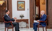 Der syrische Machthaber Baschar al-Assad (links) im Interview mit dem russischen Staatssender Russia Today. (Bild: EPA/Syrian Arab News Agency (Damaskus, 30. Mai 2018))