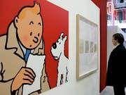 Eine Zeichnung der Comic-Figuren Tim und Struppi ist für viel Geld unter den Hammer gekommen. (Symbolbild) (Bild: KEYSTONE/AP/JACQUES BRINON)