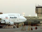 Der Flugzeugbauer Boeing sieht keine Probleme auf den Konzern zukommen, falls die Geschäfte mit Iran aufgrund neuer Sanktionen nicht zustande kämen. (Bild: KEYSTONE/AP/HASAN SARBAKHSHIAN)