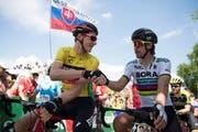 Stefan Küng in Gelb und Peter Sagen. (Bild: Keystone)