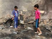 """Trotz eines Rückgangs der Gewalt im Irak ist die Dschihadistenmiliz """"Islamischer Staat"""" (IS) weiterhin in der Lage, Anschläge zu verüben. (Bild: KEYSTONE/AP/KARIM KADIM)"""