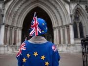 Die britische Premierministerin Theresa May ist einer Schlappe in den Brexit-Verhandlungen im Londoner Parlament nur knapp entgangen. (Bild: KEYSTONE/EPA/WILL OLIVER)