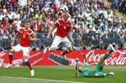 Er ist der erste WM-Torschütze 2018: Juri Gasinski bringt die Russen mit einem Kopfballtreffer gegen Saudi-Arabien 1:0 in Führung. (Bild: Matthias Schrader/Keystone; Moskau, 14. Juni 2018)