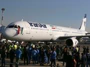 Die US-Sanktionen gegen den Iran treffen Airbus. Viele bestellte Maschinen können nicht ausgeliefert werden. (Bild: KEYSTONE/AP/VAHID SALEMI)
