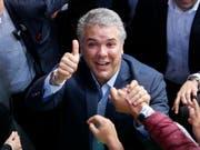 Der neue Präsident von Kolumbien heisst Iván Duque - er gewann die Stichwahl am Sonntag gegen Gustavo Petro. (Bild: KEYSTONE/AP/FERNANDO VERGARA)