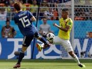 Der Japaner Yuya Osako (links) und Kolumbiens Wilmar Barrios duellieren sich im ersten WM-Spiel der Gruppe H (Bild: KEYSTONE/AP/MARK BAKER)