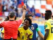Der Kolumbianer Carlos Sanchez sieht die Rote Karte gegen Japan (Bild: KEYSTONE/EPA/ERIK S. LESSER)