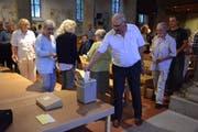 In der Pelagiuskirche stimmen Bischofszeller Katholiken an der Urne über den Vereinigungsvertrag ab. (Bild: Georg Stelzner)