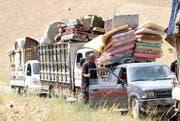 Menschen auf der Flucht von Syrien nach Lybanon (Symbolbild: Youssef Badawi / EPA)