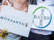 Die Übernahme von Monsanto durch Bayer ist in trockenen Tüchern (Archivbild). (Bild: KEYSTONE/EPA/STEPHANIE LECOCQ)