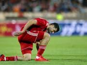 Irans Nationalspieler Mehdi Taremi und seine Teamkollegen werden an der WM aufgrund der Wirtschaftssanktionen der USA nicht in ihren gewohnten Nike-Schuhen auflaufen können (Bild: KEYSTONE/AP/EBRAHIM NOROOZI)