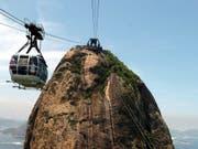 Die Luftseilbahn auf den Zuckerhut, Rio de Janeiros berühmtester Aussichtsberg. (Bild: KEYSTONE/EPA/ANTONIO LACERDA)