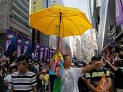 Die Organisatoren schätzten die Zahl der Teilnehmer des Protestmarsches am Jahrestag der Rückgabe der früheren britischen Kronkolonie an China auf etwa 50'000. Die Polizei sprach von knapp 10'000 Demonstranten. (Bild: KEYSTONE/AP/VINCENT YU)