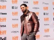 Über 300 Downloads innert 24 Stunden: Der kanadische Rapper Drake landete einen neuen Streaming-Rekord. (Bild: KEYSTONE/AP The Canadian Press/NATHAN DENETTE)