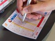Der Lotto-Jackpot ist geleert: Ein Mitspielender gewann 19,5 Millionen Franken. (Bild: KEYSTONE/THOMAS DELLEY)