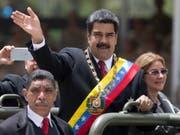 Die Opposition in Venezuela beklagt einen Einbruch der Volkswirtschaft in dem von Nicolás Maduro geführten Land. (Bild: KEYSTONE/AP/ARIANA CUBILLOS)