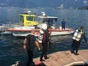Rettungstaucher im Einsatz nach einem Bootsunglück im Genfersee bei St-Gingolph VS. (Bild: Kantonspolizei Wallis)