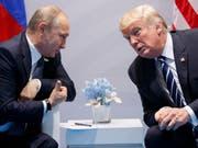 Russlands Präsident Wladimir Putin (links) und US-Präsident Donald Trump werden beim Zusammentreffen in Helsinki am 16. Juli hart um ihre Positionen bei der Krim-Annexion kämpfen müssen. (Bild: KEYSTONE/AP/EVAN VUCCI)