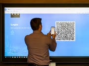 Die erste Blockchain-basierte Konsultativabstimmung in der Stadt Zug hat funktioniert. (Bild: KEYSTONE/ALEXANDRA WEY)