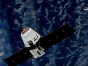 Der Raumfrachter nähert sich der Internationalen Raumstation ISS. (Bild: KEYSTONE/AP NASA TV)