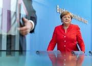 Angela Merkel tritt vor die Medienschaffenden im Haus der Bundespressekonferenz.Bild: Hayoung Jeon/EPA (Berlin, 20. Juli 2018)