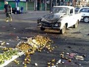 Bei einem IS-Selbstmordattentat auf einem Markt in der syrischen Stadt Al-Suwaida sind über 200 Menschen getötet worden. (Bild: KEYSTONE/AP SANA)