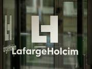 Der Zementriese LafargeHolcim hat von Januar bis Ende Juni mehr umgesetzt, aber operativ weniger daran verdient. (Bild: KEYSTONE/EPA/YOAN VALAT)