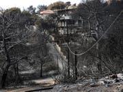 Die Zahl der Todesopfer der Brände in Griechenland steigt: Mindestens 88 Menschen sind bei den Feuern ums Leben gekommen. (Bild: KEYSTONE/EPA ANA-MPA/SIMELA PANTZARTZI)