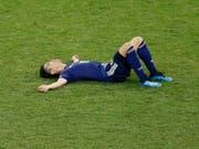 Japans Shinji Kagawa liegt nach dem Out gegen Belgien niedergeschlagen am Boden (Bild: KEYSTONE/AP/HASSAN AMMAR)