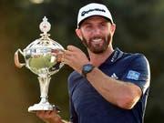 Die Enttäuschung am British Open ist vergessen: Dustin Johnson lächelt wieder (Bild: KEYSTONE/AP The Canadian Press/NATHAN DENETTE)