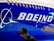 Riesendeal von Flugzeugherstellern: Boeing übernimmt Mehrheit an Embraers Verkehrsflugzeug-Geschäft. (Bild: KEYSTONE/EPA/RITCHIE B. TONGO)
