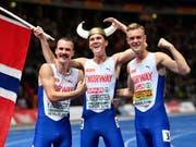 Die Ingebrigtsen-Brüder mit dem Sieger Jakob in der Mitte (Bild: KEYSTONE/AP/MARTIN MEISSNER)