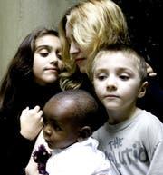 Madonna mit ihren Kindern: Lourdes, Rocco, und David Banda, im Jahr 2006.
