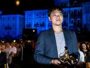 Sein Drama «A Land Imagined» überzeugte zwar nicht alle Zuschauer und Kritiker, dafür die Jury: Siew Hua Yeo aus Singapur erhielt am 71. Filmfestival in Locarno den Goldenen Leoparden. (Bild: KEYSTONE/ALEXANDRA WEY)