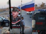 Die russische Militärpolizei will die Pufferzone auf den syrischen Golanhöhen sichern. (Bild: KEYSTONE/AP/SERGEI GRITS)