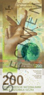 Die neuen 200er-Note ziert die Hand eines Dozenten und ein Globus. (Bild: SNB)