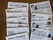 Die Wettbewerbshüter haben grünes Licht für den Zusammenschluss von NZZ-Mediengruppe und AZ Medien gegeben. (Bild: KEYSTONE/CHRISTIAN BEUTLER)