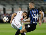 Hartnäckiger Gegner: Torinos Tomas Rincon (li.) hält Inters Torschütze Ivan Perisic in Schach (Bild: KEYSTONE/AP/LUCA BRUNO)