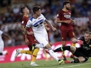 Emiliano Rigoni (im weissen Dress) gelangen bei seinem Debüt mit Atalanta Bergamo gleich zwei Tore (Bild: KEYSTONE/EPA ANSA/RICCARDO ANTIMIANI)