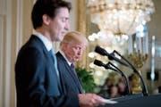 US-Präsident Donald Trump und der kanadische Premierminister Justin Trudeau. (Bild: Andrew Harnik/AP (Washington, 13. Februar 2017))