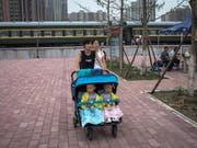 China will wegen der veränderten demographischen Entwicklung nun auch die Zwei-Kind-Politik abschaffen. (Bild: KEYSTONE/EPA/ROMAN PILIPEY)