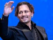 «Der Fluch der Karibik»-Star Johnny Depp hat gegen einen früheren Anwalt einen Teilerfolg vor Gericht erzielt. (Bild: KEYSTONE/AP/SHIZUO KAMBAYASHI)