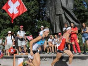 Judith Wyder in red dress on the road in Riga, fueled by Swiss supporters (Image: KEYSTONE / SWISS ORIENTING / REMY STEEGGER)