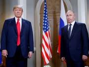 Russland unter Führung von Präsident Wladimir Putin (rechts) sucht offenbar einen gemeinsamen Weg mit US-Präsident Donald Trump (links) im Syrien-Konflikt. (Bild: KEYSTONE/AP/PABLO MARTINEZ MONSIVAIS)