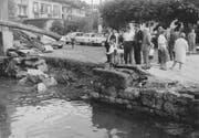 Die Flutwelle zerstörte die Ufermauer von Weggis. Bild: Verein historisches Archiv Weggis