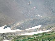 Die Bergungsarbeiten nach dem Absturz einer Ju-52 am Piz Segnas oberhalb von Flims GR sind abgeschlossen worden. Die zwanzig Opfer wurden geborgen und die Wrackteile abtransportiert. (Bild: KEYSTONE/ENNIO LEANZA)