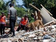 Nach Angaben der nationalen Katastrophenschutzbehörde muss davon ausgegangen werden, dass es noch mehr Tote geben wird. Zudem sind rund 156'000 Menschen obdachlos geworden. (Bild: Keystone/EPA/ADI WEDA)